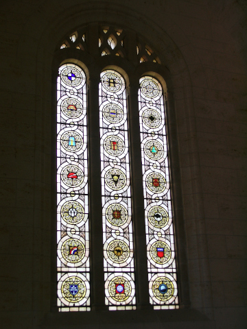 The stained glass windows show unit insignia
